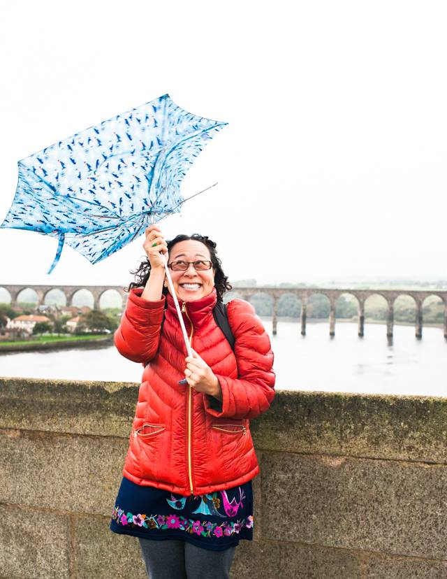 Me with a flimsy umbrella at Berwick-upon-Tweed, July 2016. Photo by Stephanie Shih.